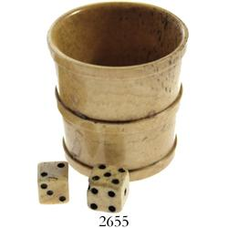 Bone cup in the shape of a bucket with two bone dice, ca. 1860s.