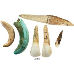 Lot of 6 items: 4 animal teeth and one bone fragment, all with letters engraved on them; and 1 crab