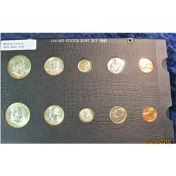 24. 1961 P & D U.S. Mint Set in old Wayte Raymond holder. Gem BU.