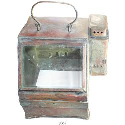 Lionel Mark 1 U.S. Navy copper binnacle cover with oil-lamp light box on side and handle on top.