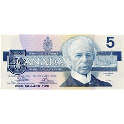 BANK OF CANADA.  $5.00.  1986 Issue.  BC-56aA-i.  Blue B.P.N.  Crow-Bouey.  No. ENX3001728.  AU+.