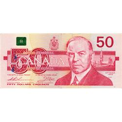 BANK OF CANADA. $50. 1988 Issue. BC-59aA. No EXH3411143. PMG Fine-15. Light tears & ink mark. A rada