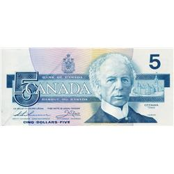BANK OF CANADA.  $5.00.  1986 Issue.  BC-56b.  No. FOR3403997.  PMG graded Very Fine-30. Net.  Fold