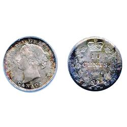 1881-H.  Obverse port. #2.  PCGS graded Mint State-66. Lovely silver gray and rose patina, with blue