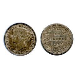1882-H.  ANACS graded AU-55, (new holder).  Medium heavy toning.  A conservatively graded ten cents