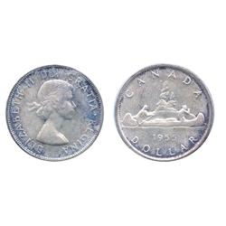 1955.  ICCS Mint State-65.  Light to medium heavy blue and purple toning.  Another gem.