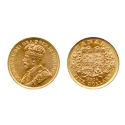 $5.00 Gold.  1913.  ICCS AU-55.  Light orange and yellow luster.