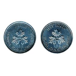 TEST Token.  $1.00.  CH-TT-100.1.  Round Large size.  Three Maple Leaves.  1983.  Counterstamped 'N.