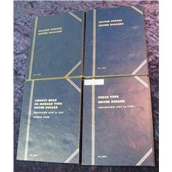 32. (4) U.S. Silver Dollar used Whitman folders. Empty.