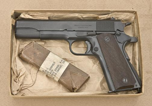 Model 1911 A1  45 ACP caliber U S  military-issue pistol by Ithaca, serial  #908309  The pistol rem