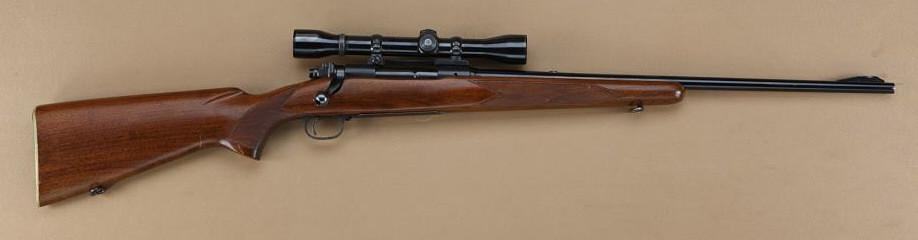 "Winchester Pre-64 model 70 featherweight,  243 Winchester caliber, factory  22"" barrel, standard co"