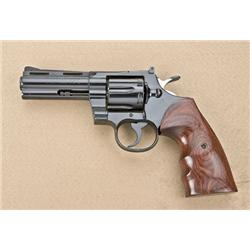 "Colt Python Model DA revolver, .357 cal., 4""  ventilated rib barrel, blue finish, custom  finger gro"