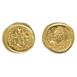 JUSTINIAN I, AD 527-565. Gold Solidus (4.47 g.) minted at Constantinople. Obv: Helmeted and cuirasse