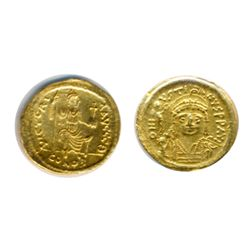 JUSTINIAN II, AD 565-578. Gold Solidus (4.46g) minted at Constantinople. Obv: Helmeted and cuirassed