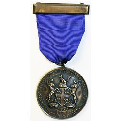 H.B.C. Long Service Medal. Presented to E.H. Villous, 1944 for 15 Years of Faithful Service. Miss. V