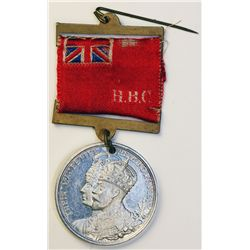 H.B.C. King George V and Queen Mary. Coronation medal, with hangers supporting a red ribbon with ens