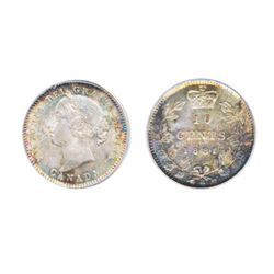 1881-H. PCGS graded Mint State-66. Lovely silver gray and rose patina, with blue highlights. Near fl