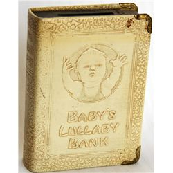 "BABY'S LULLABY BANK. Slot opening at top, ""For Coins and Bills"". Key lock, key present. No serial nu"