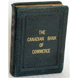 THE CANADIAN BANK OF COMMERCE. 'BOOK OF THRIFT' on spine. Coin opening on top. Key lock, key present