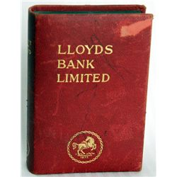 LLOYDS BANK LIMITED. Coin slot and currency hole on side. Key lock, with key present. Serial number