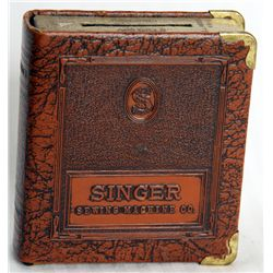 SINGER SEWING MACHINE CO. Coin slot on top. Key lock, with no key present. No serial number. 8cm x 9