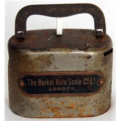 THE BERKEL AUTO SCALE CO LD, LONDON. An oval satchel bank. Coin slot at right, banknote hole right.