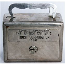 THE BRITISH COLUMBIA TRUST CORPORATION. Savings Department. A square satchel bank. Coin slot and ban