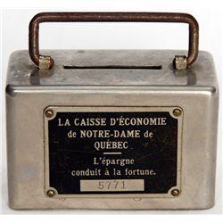 LA CAISSE D'ECONOMIE DE NOTRE-DAME DE QUEBEC. A small rectangular steel satchel bank with rounded ed