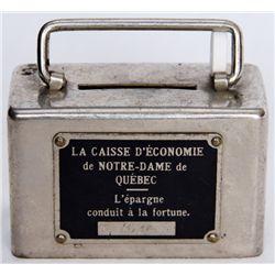 LA CAISSE D'ECONOMIE DE NOTRE-DAME DE QUEBEC. A small rectangular steel satchel bank. Coin slot on t