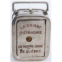 LA CAISSE D'ECONOMIE DE NOTRE-DAME DE QUEBEC. A tall steel satchel bank with rounded corners. Also k