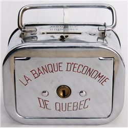 LA BANQUE D'ECONOME DE QUEBEC. A satchel bank with round corners. Coin slot on top, banknote hole at