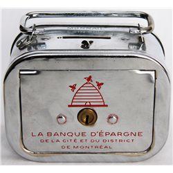 LA BANQUE D'ESPARGNE DE LA CITE ET DU DISTRICT DE MONTREAL. A satchel bank, with rounded corners. Co