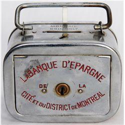 LA BANQUE D'ESPARGINE DE LA CITE ET DU DISTRICT DE MONTREAL. A rectangular satchel bank, with rounde