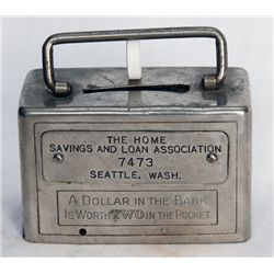 THE HOME SAVINGS AND LOAN ASSOCIATION, SEATTLE, WASH. A rectangular satchel bank. Name plate on fron