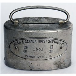 JAPAN & CANADA TRUST SAVINGS CO., VANCOUVER, B.C. Oval satchel bank. Coin slot at top. Banknote hole