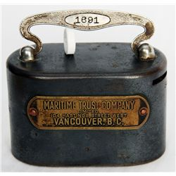 MARITIME TRUST COMPANY LIMITED. 104 HASTINGS STREET WEST, VANCOUVER, BC. An oval steel satchel bank.