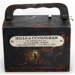 MILLS & CUNNINGHAM. BANKERS, 79 CLARENCE STREET, KINGSTON, ONTARIO. A steel satchel bank, with squar
