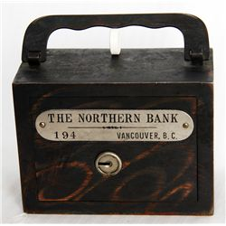 THE NORTHERN BANK, VANCOUVER, B.C. A steel satchel bank, with square corners. Coin slot at right, wi