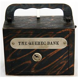 THE QUEBEC BANK. A rectangular steel satchel bank, with square corners. Coin slot on right side, wit