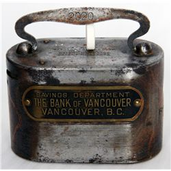 SAVINGS DEPARTMENT THE BANK OF VANCOUVER, VANCOUVER, B.C. An oval steel satchel bank. Coin slot on l