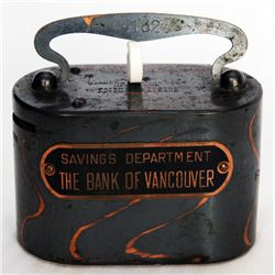 THE BANK OF VANCOUVER SAVINGS DEPARTMENT. A oval steel satchel bank. Coin slot at left. Banknote hol