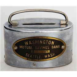 WASHINGTON MUTUAL SAVINGS BANK, SEATTLE, WASH. An oval satchel bank. Coin slot on top. Handle on top