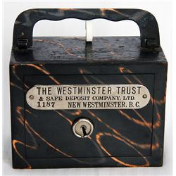 THE WESTMINSTER TRUST & SAFE DEPOSIT COMPANY, LTD. NEW WESTMINSTER, BC. A steel satchel bank, with s