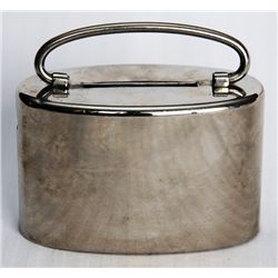 NO Name. An oval satchel bank. Coin slot on top. Handle present. Key lock, with key present. Serial