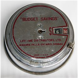 """BUDGET SAVINGS"" NIAGARA FALLS, ONTARIO. A CYLINDRICAL STEEL BANK. Slot along side. No handle, no ke"