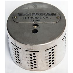 THE HOME BANK OF CANADA/ST. THOMAS, ONT. An cylindrical bank. Slots arranged horizontally along top