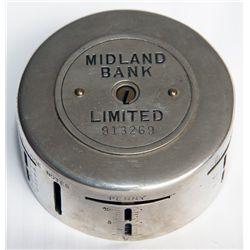 MIDLAND BANK LIMITED (UK). A cylindrical steel 'Day and Night' bank. Slots arranged horizontally alo