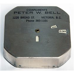 COMPLIMENTS PETER W. BELL. An octagonal Register Bank, Ten cent slot at top. 6 1/2cm x 6 1/2cm x 1 1