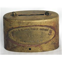JAPAN & CANADA TRUST SAVINGS CO./VANCOUVER, BC. (and in Japanese). An oval Brass bank. Coin slot on