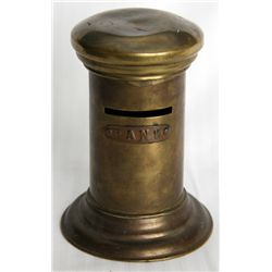 BANK'. A bank in the shape of a Cylinder, with flans at top and base. Coin slot at top. No handle, k